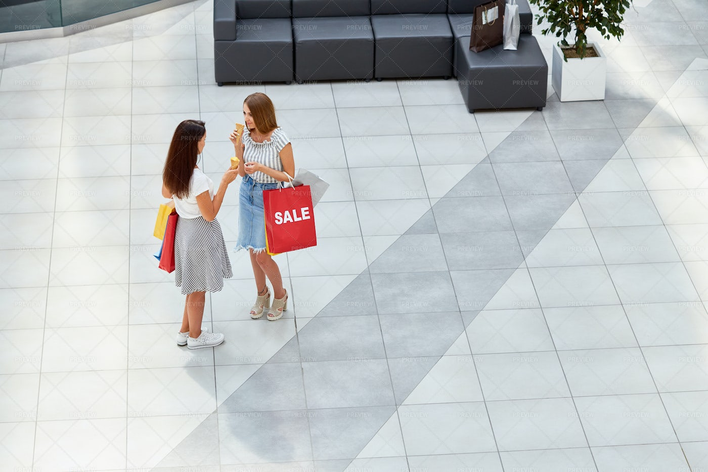 Two Girls In Shopping Center: Stock Photos