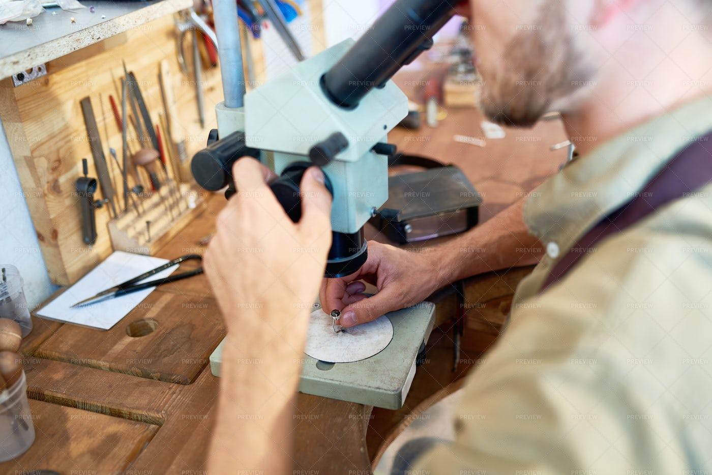 Jeweler Examining Ring: Stock Photos