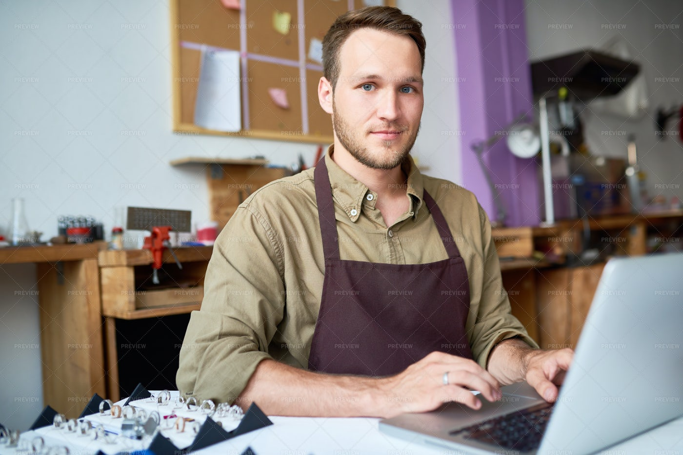 Young Man Using Laptop In Jewelry...: Stock Photos
