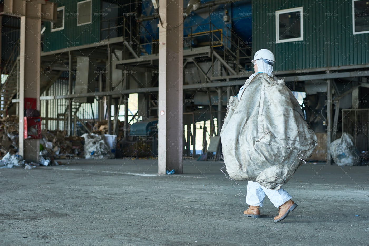 Worker In Warehouse Of  Recycling...: Stock Photos