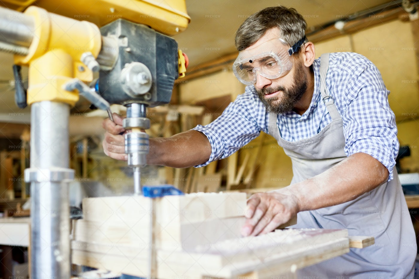 Bearded Carpenter Wrapped Up In...: Stock Photos