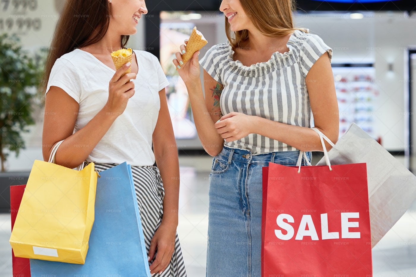 Pretty Girls Shopping In Mall On...: Stock Photos