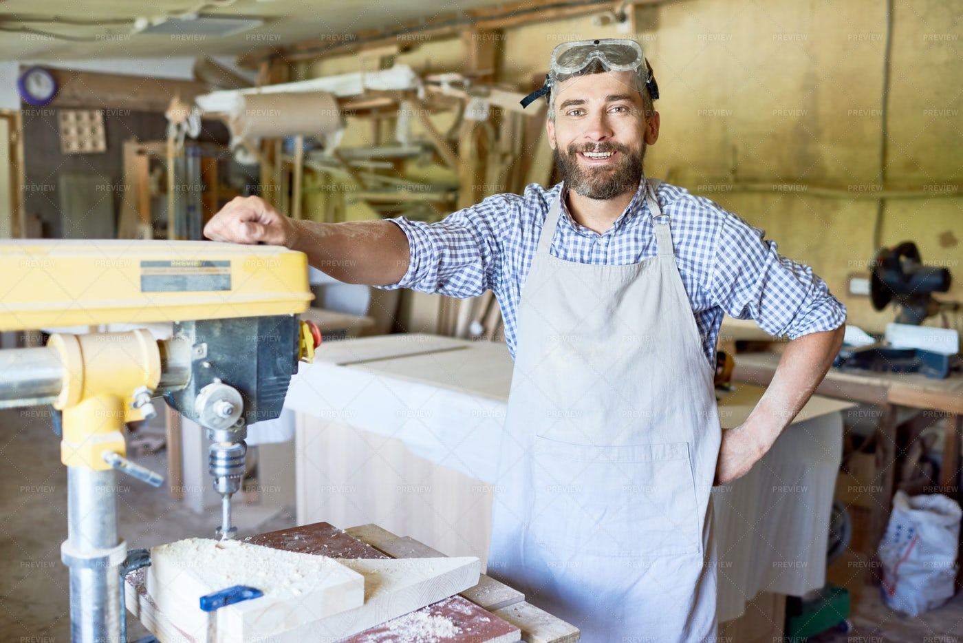 Handsome Carpenter At Drill Press...: Stock Photos
