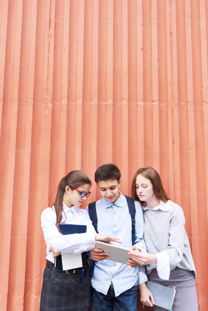 Teenage Students Collaborating On...: Stock Photos