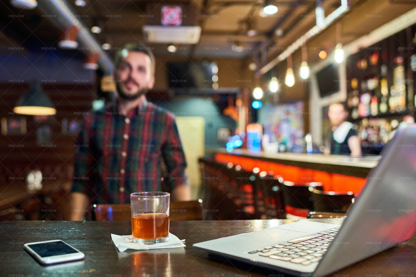 Young Man Working In Bar: Stock Photos
