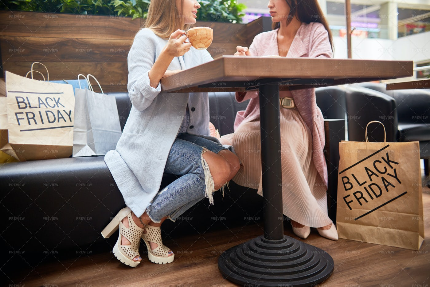 Young Women In Cafe Of Shopping...: Stock Photos