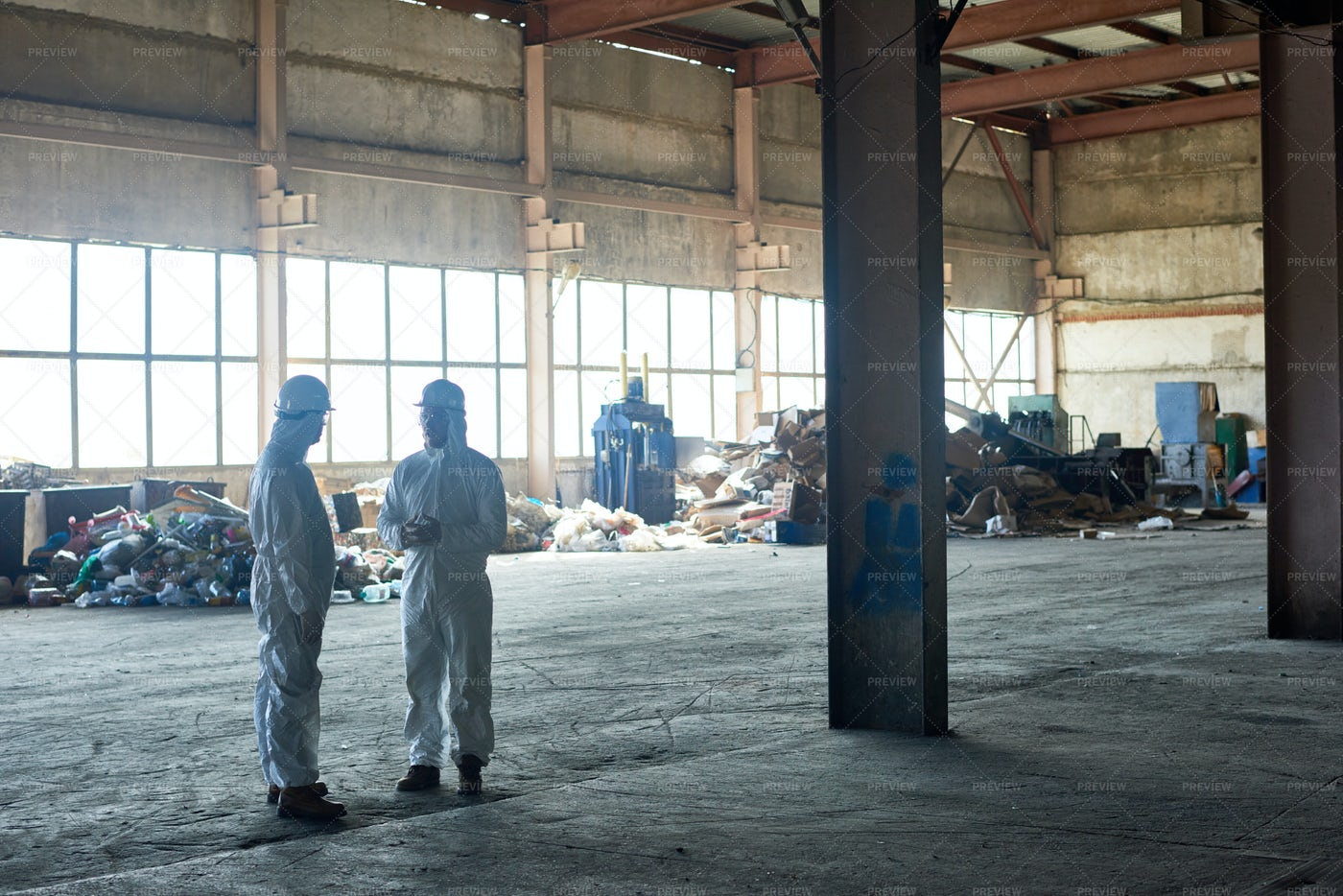 Workers In Empty Waste Processing...: Stock Photos
