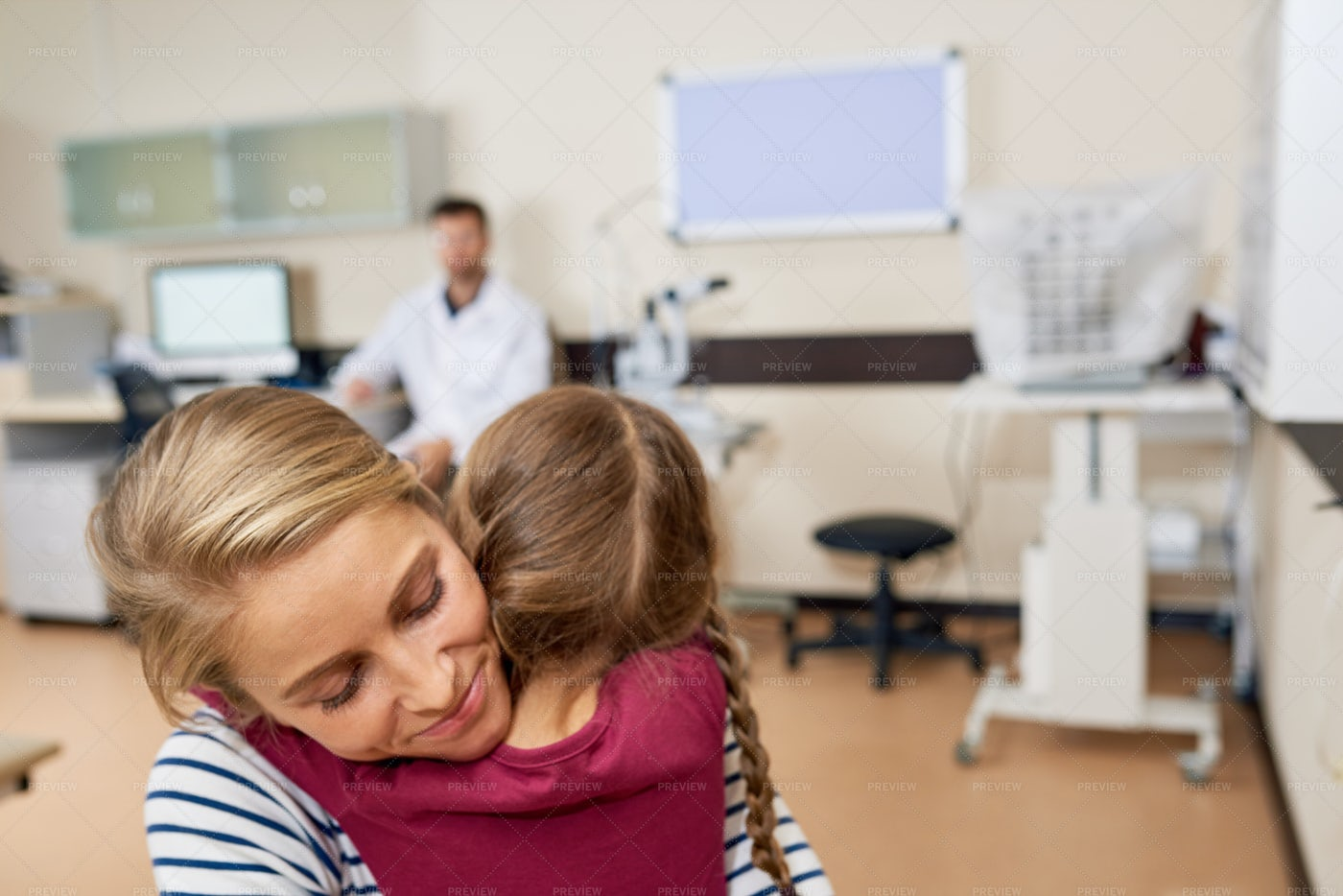 Little Girl Hugging Mom In Doctors...: Stock Photos
