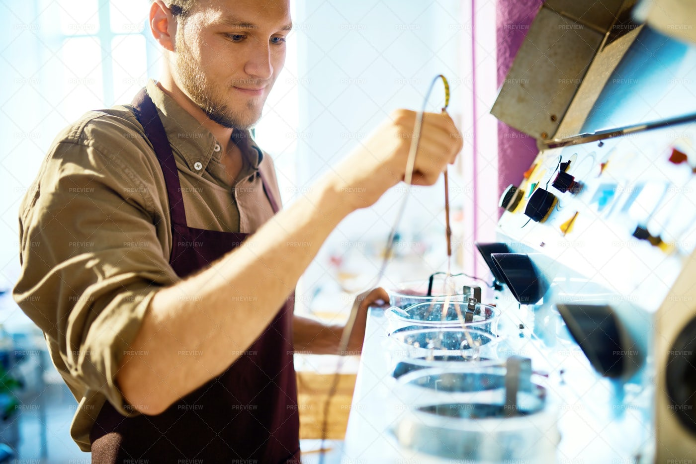 Young Man Working With Machine: Stock Photos
