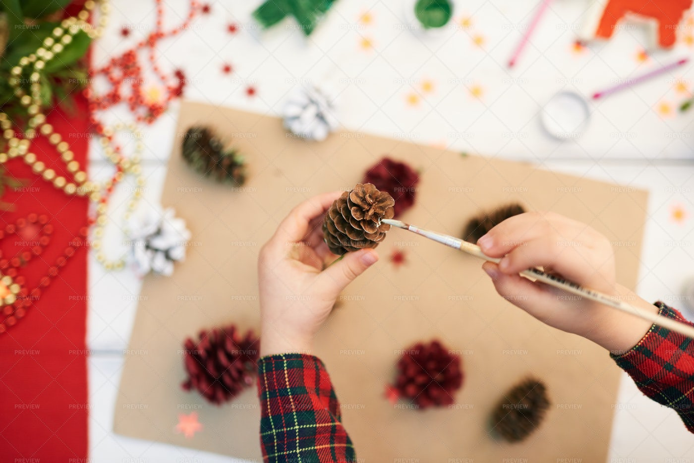 Covering Pinecone With Gouache: Stock Photos