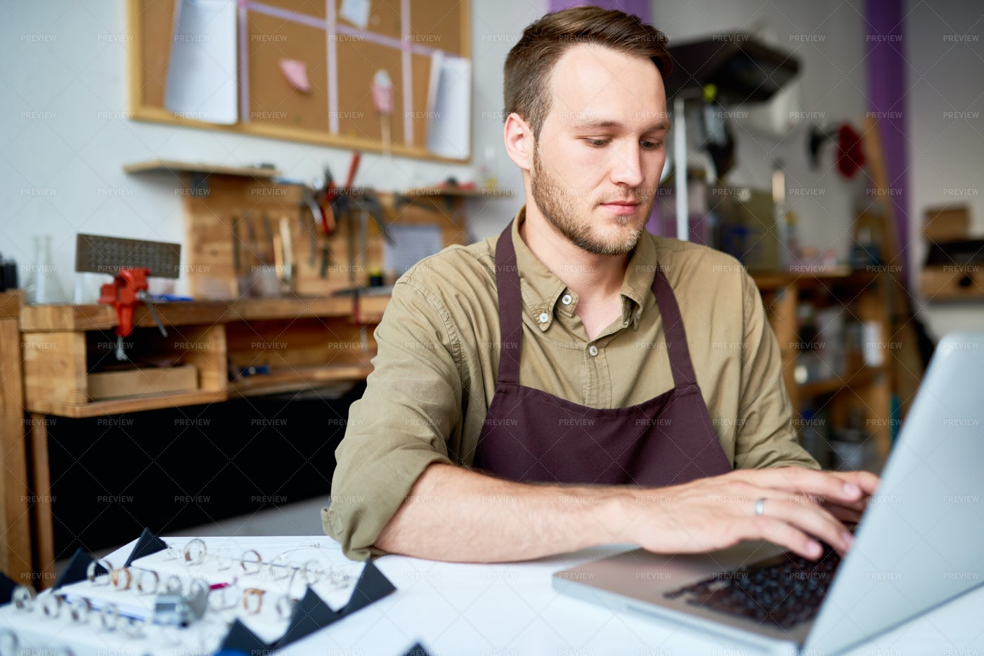 Jeweler Using Laptop In Shop: Stock Photos