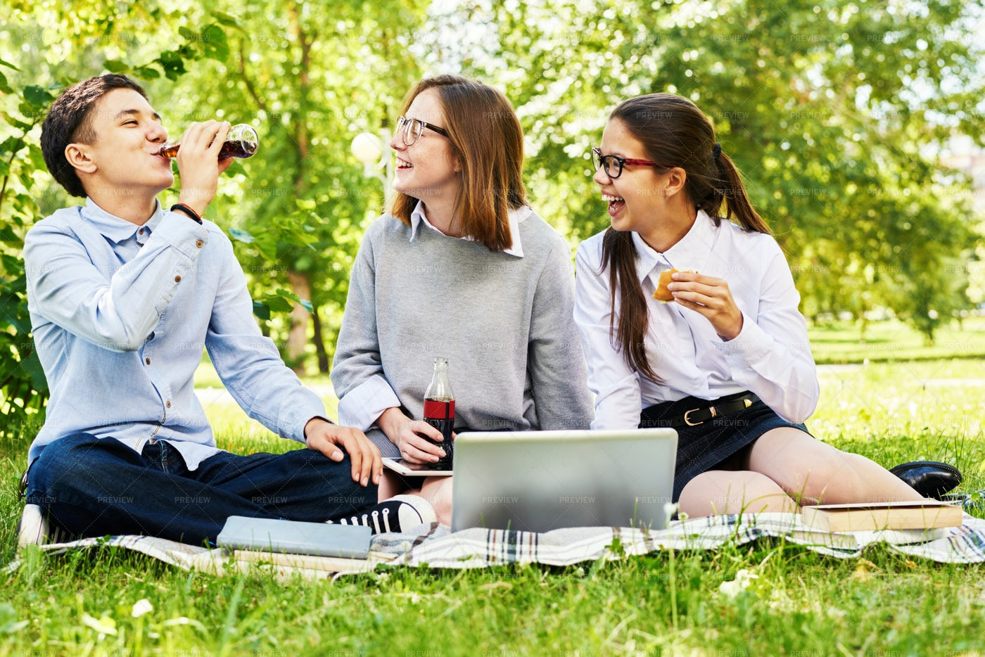 Teenage Kids Relaxing On Green Lawn: Stock Photos