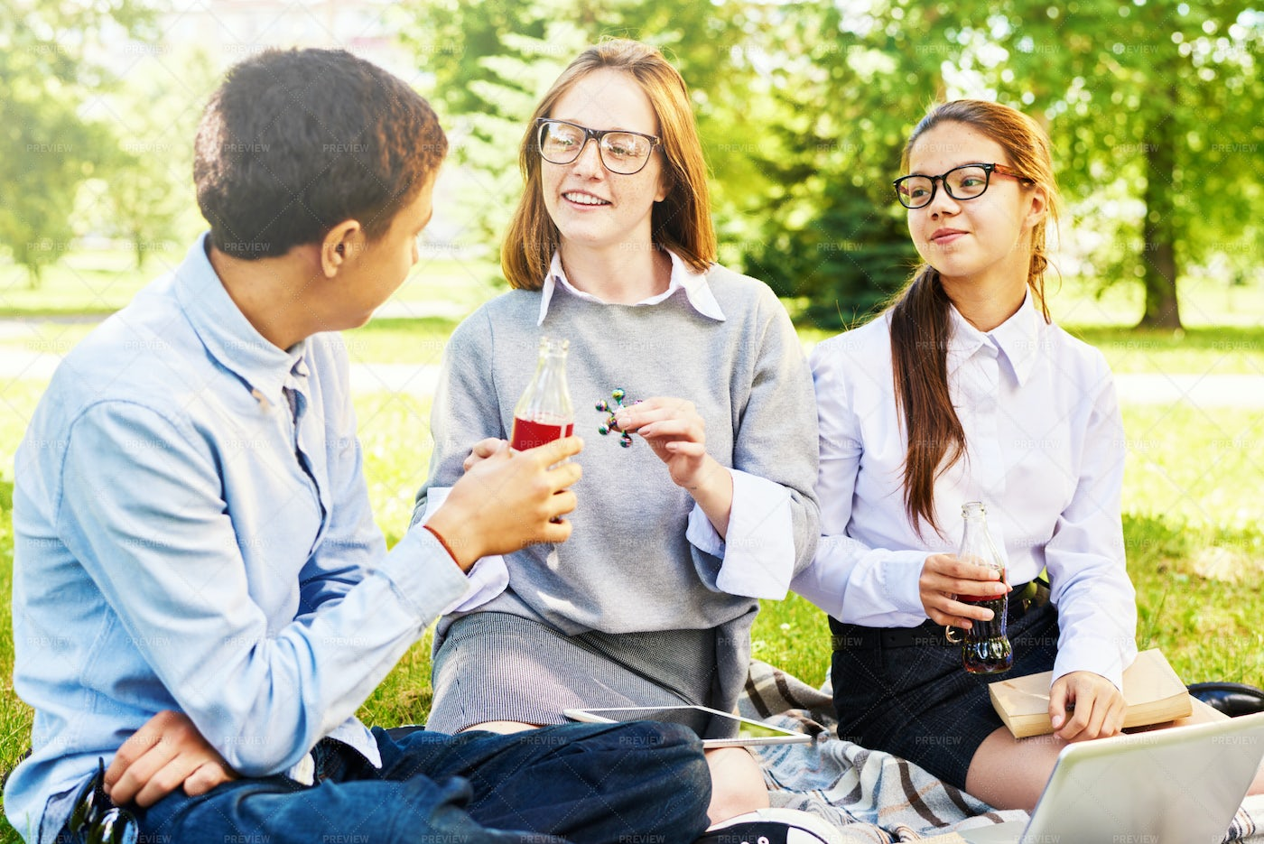 School Friends Chatting Outdoors: Stock Photos