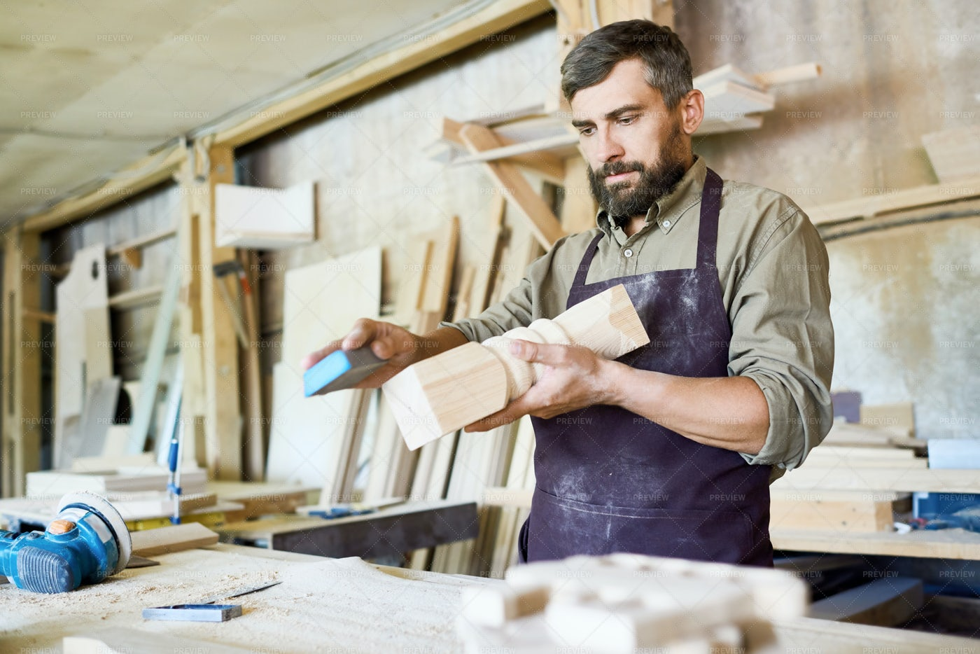 Bearded Craftsman Wrapped Up In...: Stock Photos