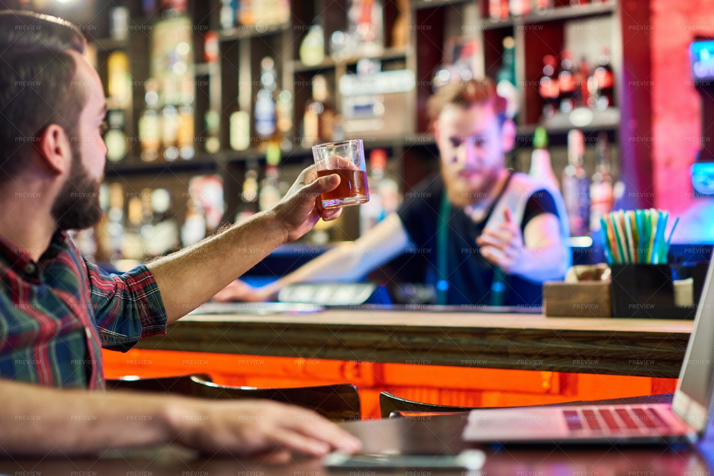 Young Man Toasting To Bartender: Stock Photos