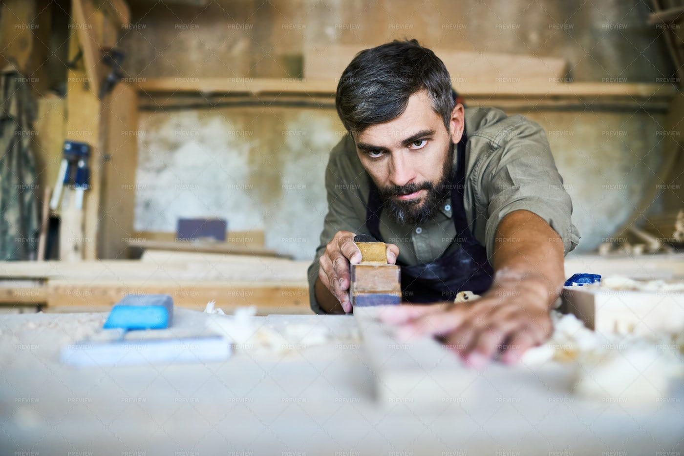 Handsome Craftsman Planing Plank: Stock Photos