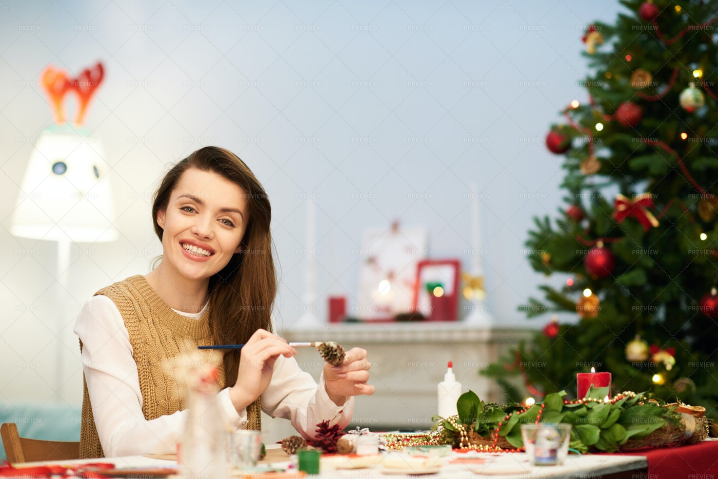 Attractive Woman Making Christmas...: Stock Photos