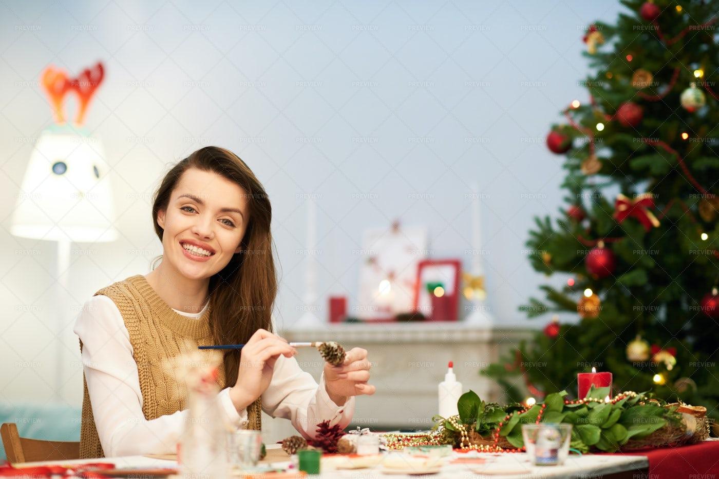 Attractive Woman Making Christmas...: Stock Photos