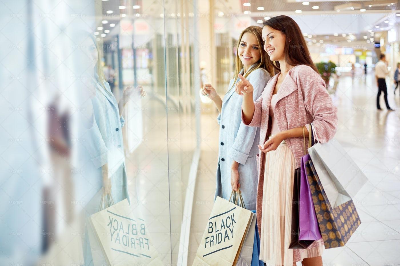 Young Women Window Shopping In Mall: Stock Photos