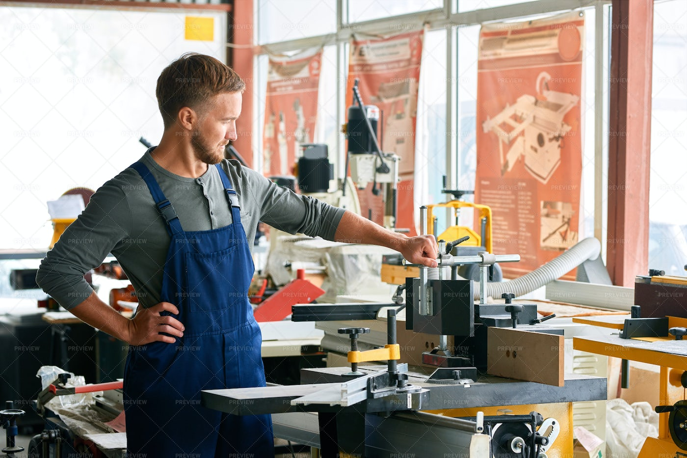 Young Workman Inspecting Machines...: Stock Photos