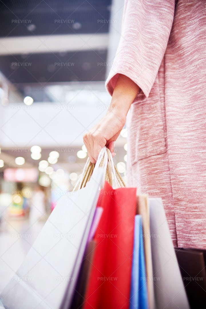 Young Woman Holding Shopping Bags: Stock Photos