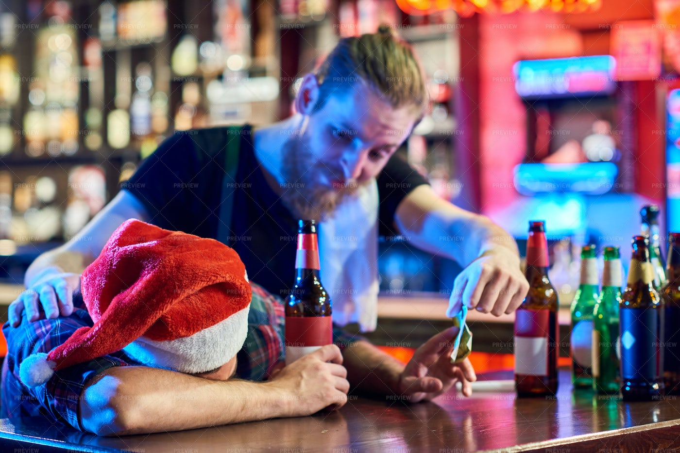 Drunk Man At Christmas Party In Pub: Stock Photos