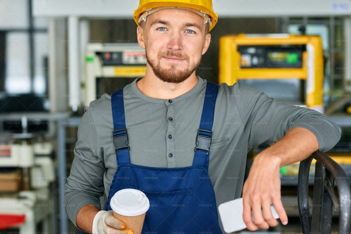 Smiling Young Workman Posing On...: Stock Photos