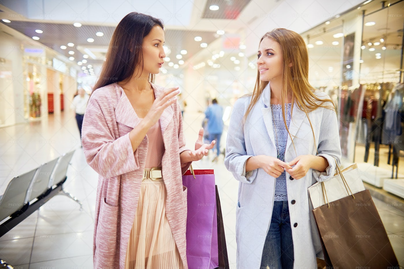 Two Young Women Enjoying Shopping: Stock Photos
