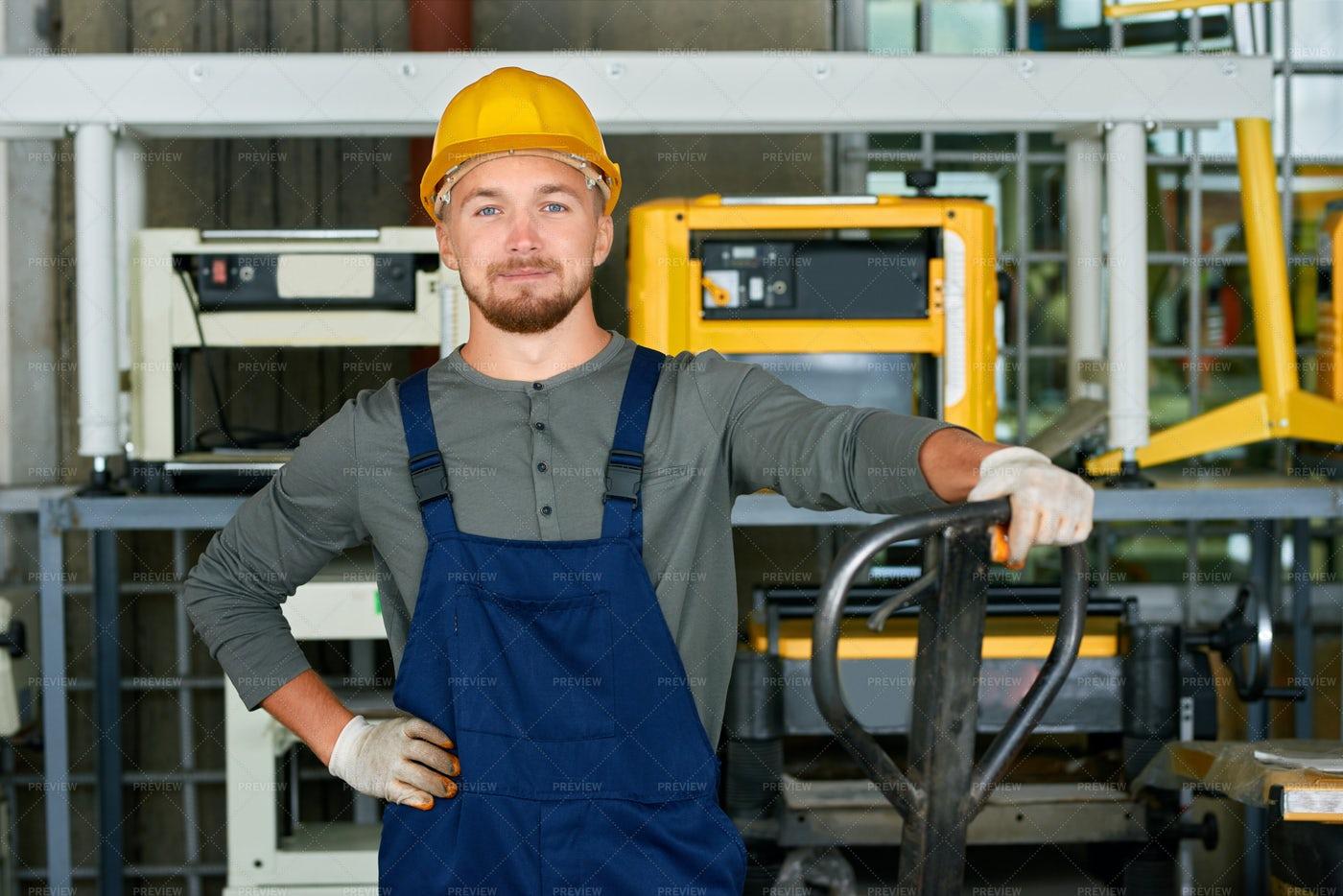 Young Workman Posing At Factory: Stock Photos