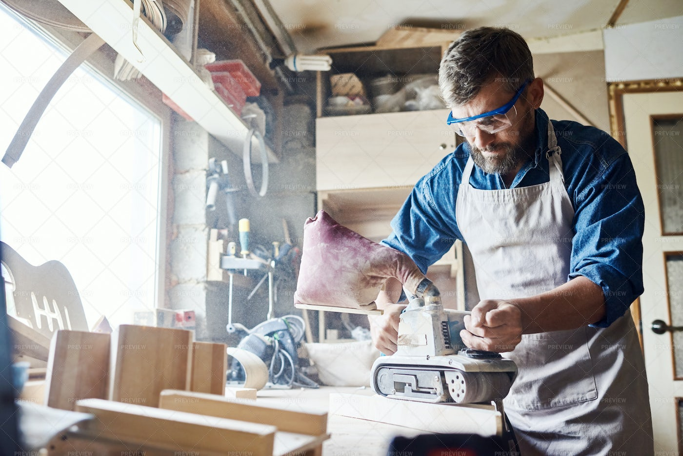 Concentrated Carpenter With Belt...: Stock Photos