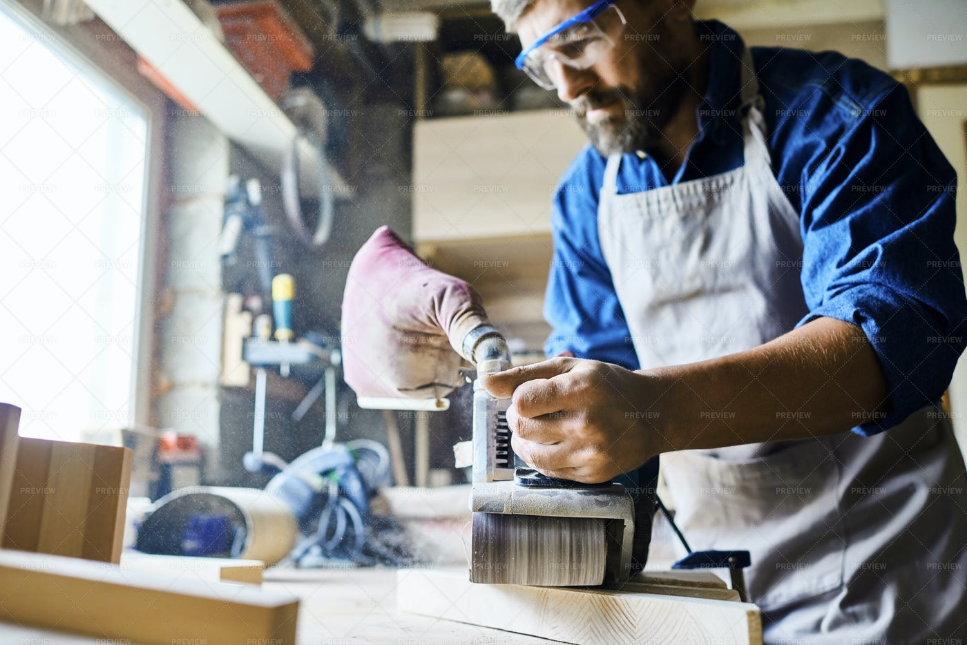 Skilled Carpenter Working With Wood: Stock Photos