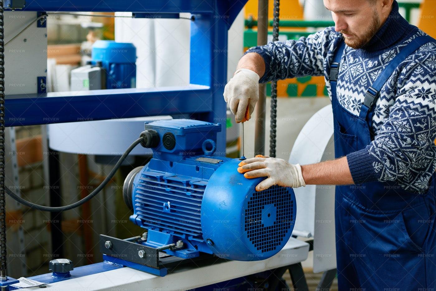 Repairman Fixing Machine Units At...: Stock Photos