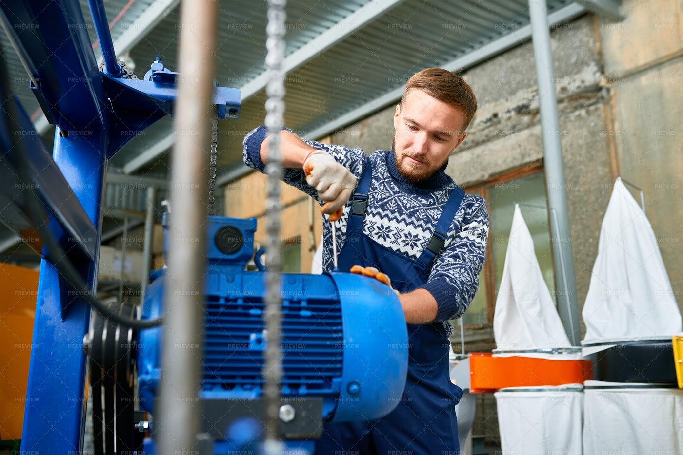 Man Repairing Machine Units At...: Stock Photos