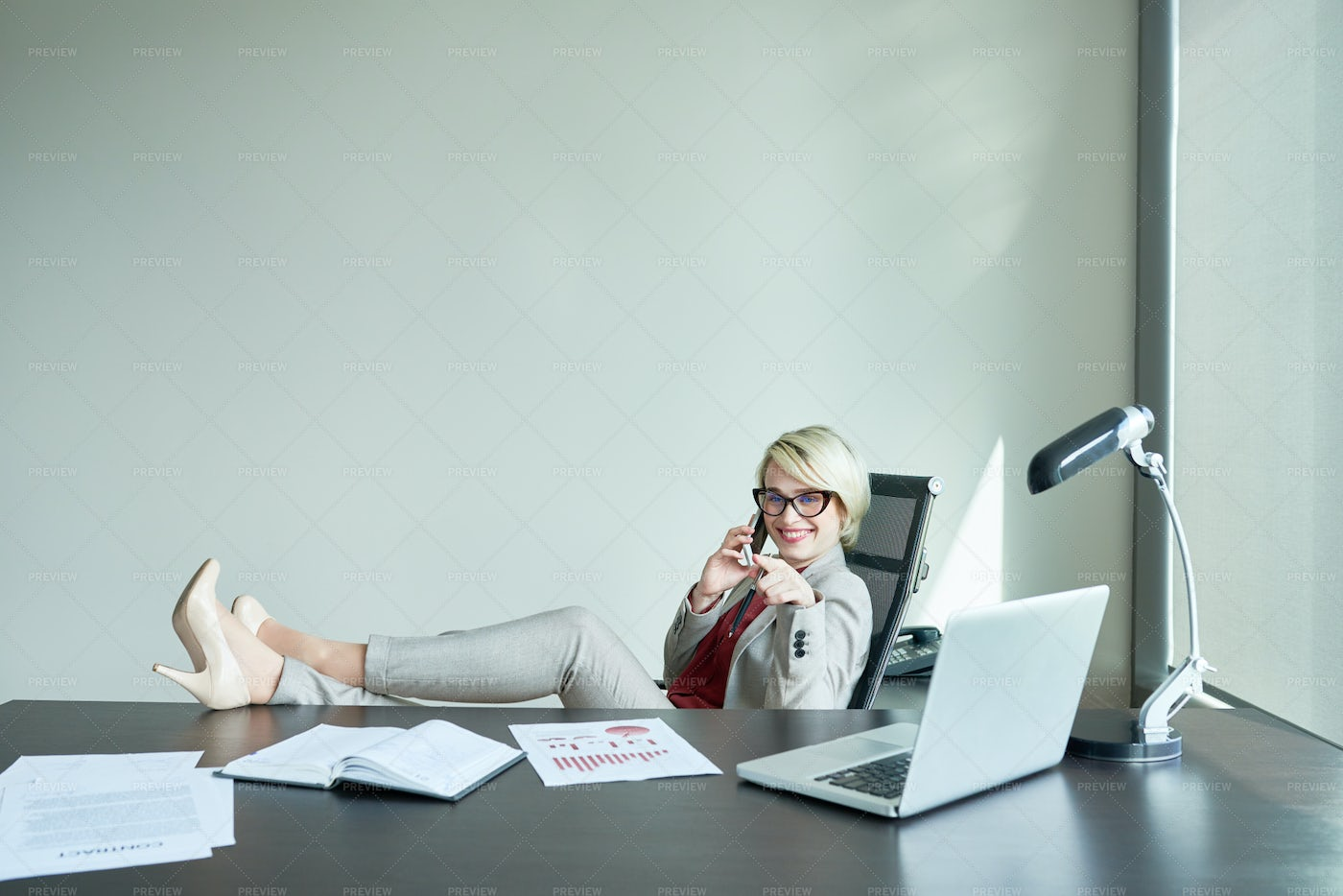 Laid-Back Business Woman At...: Stock Photos