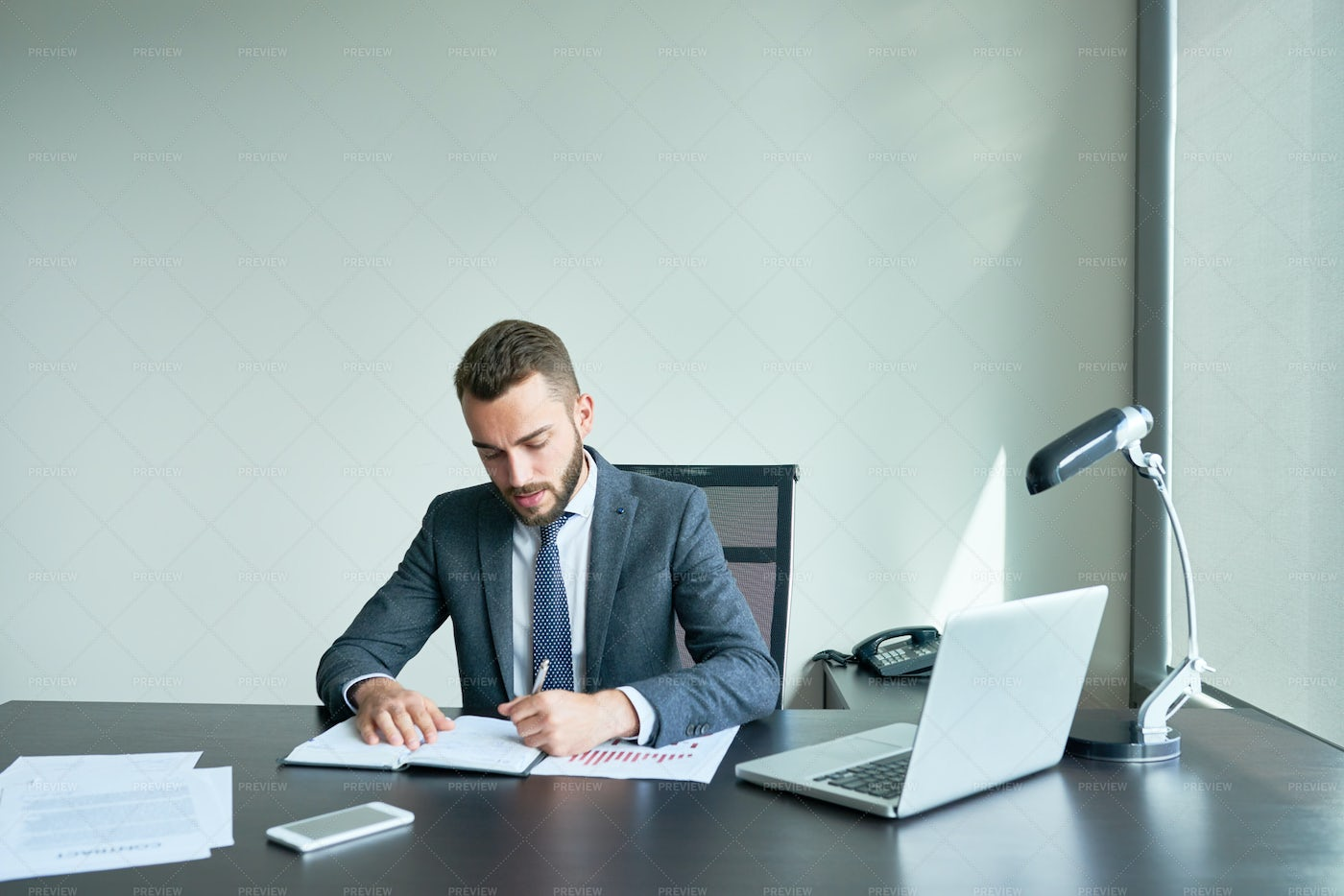 Bearded Entrepreneur Wrapped Up In...: Stock Photos