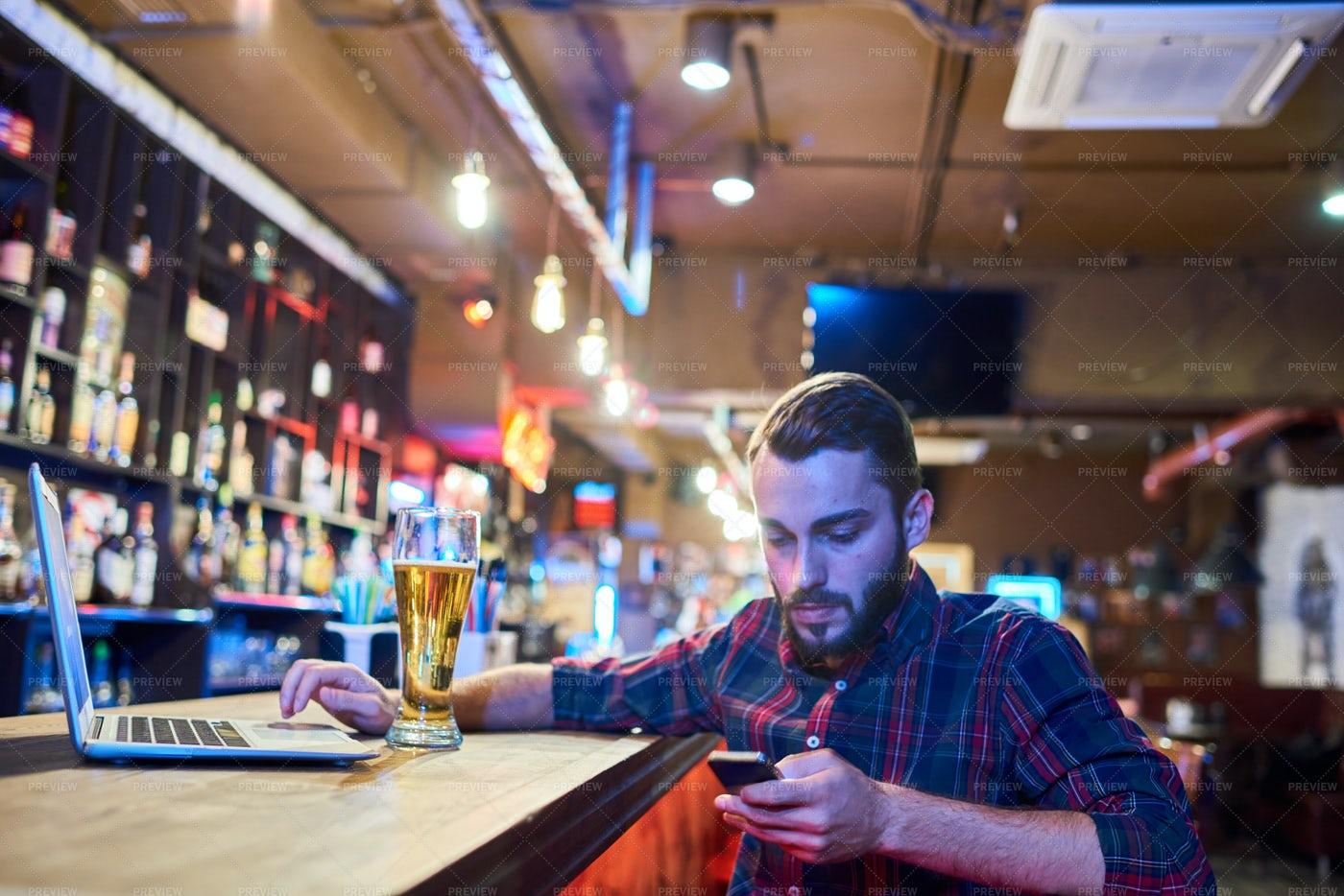 Man Using Smartphone In Pub: Stock Photos