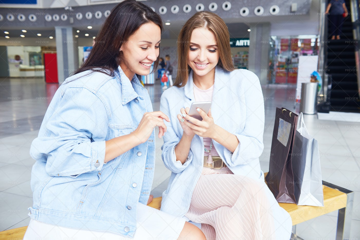 Two Girls Using Smartphone In...: Stock Photos
