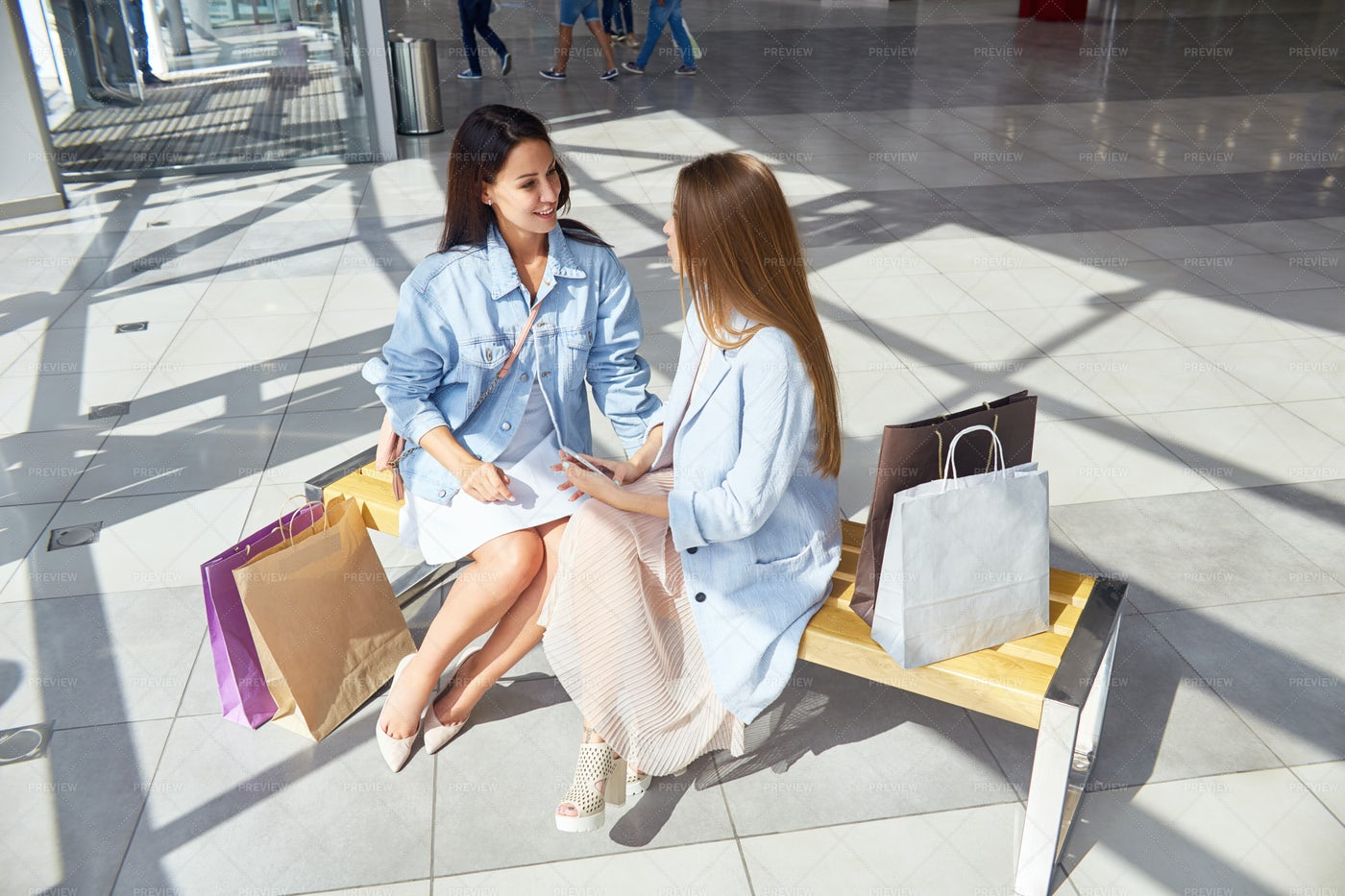 Two Girls Chatting In Mall: Stock Photos