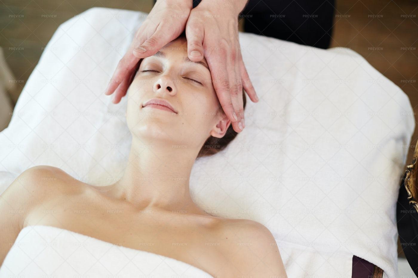 Woman Enjoying Face Lifting Massage...: Stock Photos