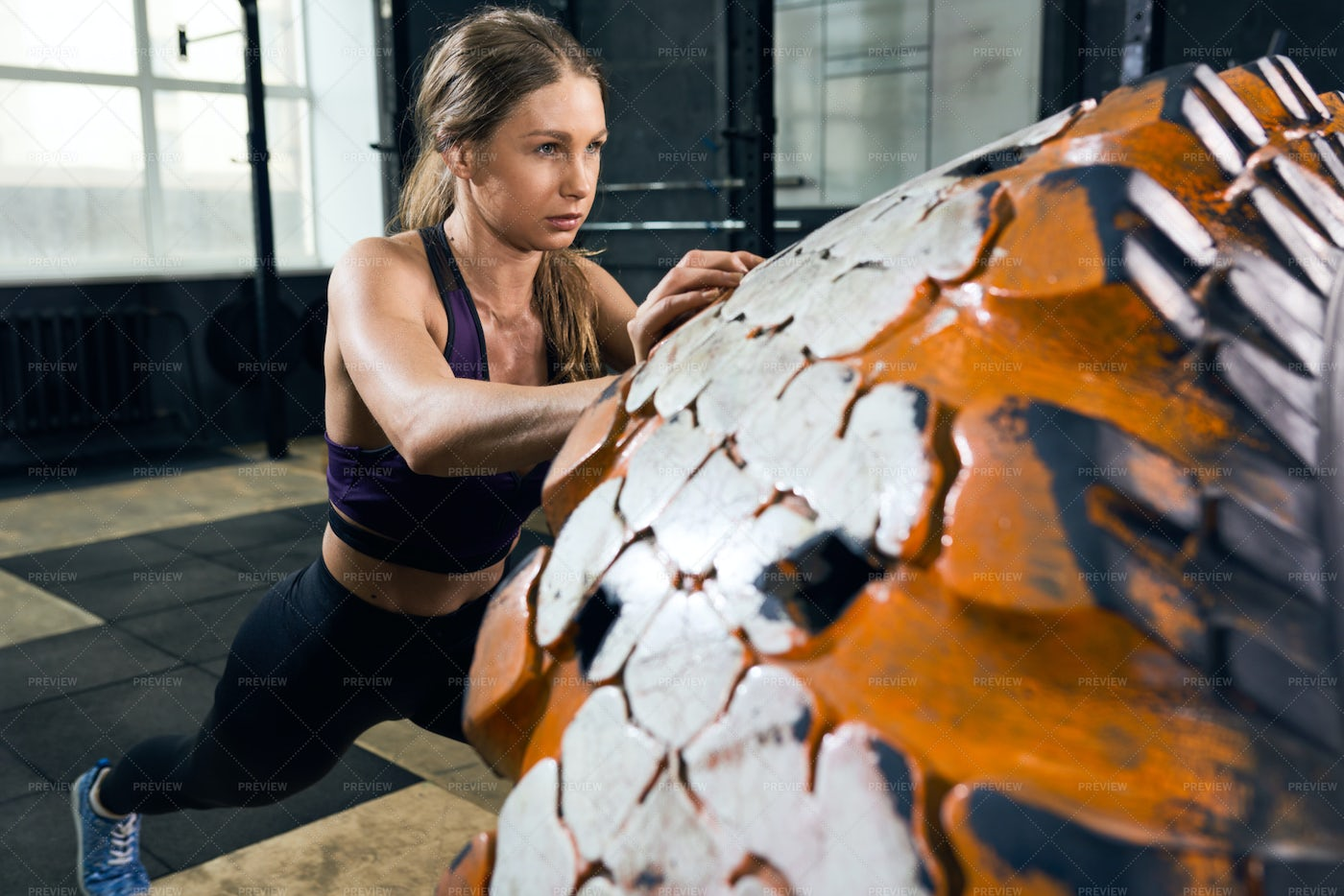 Woman Flipping Tire In Gym: Stock Photos