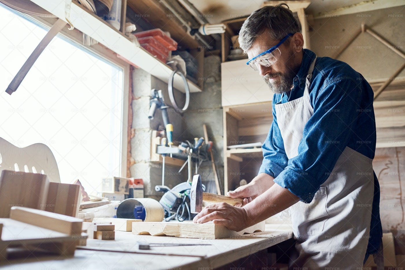 Hammering Nails Into Board: Stock Photos