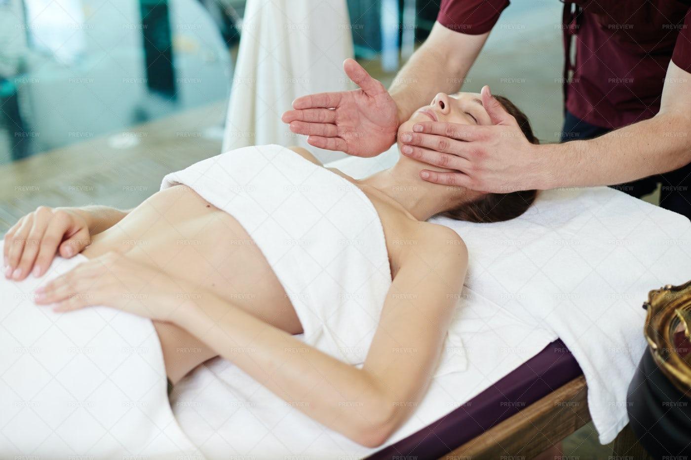 Male Masseur Massaging Young Woman...: Stock Photos