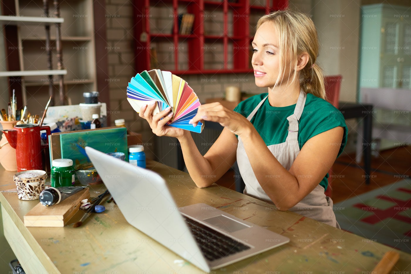 Creative Young Woman In Workshop: Stock Photos