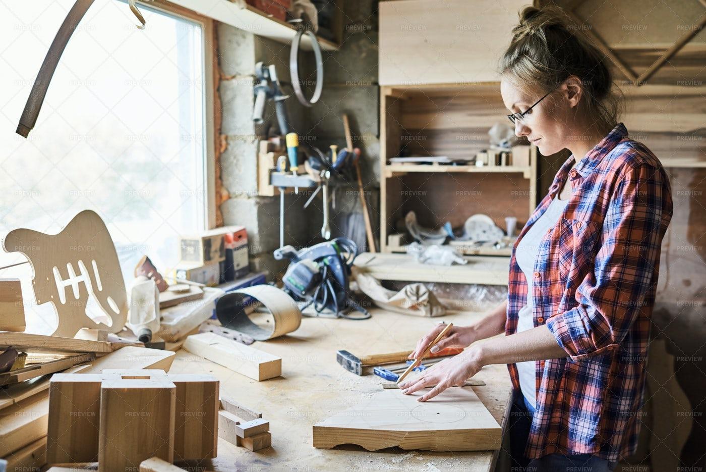 Pretty Craftswoman Measuring Plank: Stock Photos