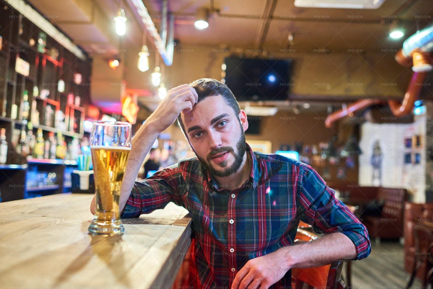 Young Man Sitting At Bar Counter: Stock Photos
