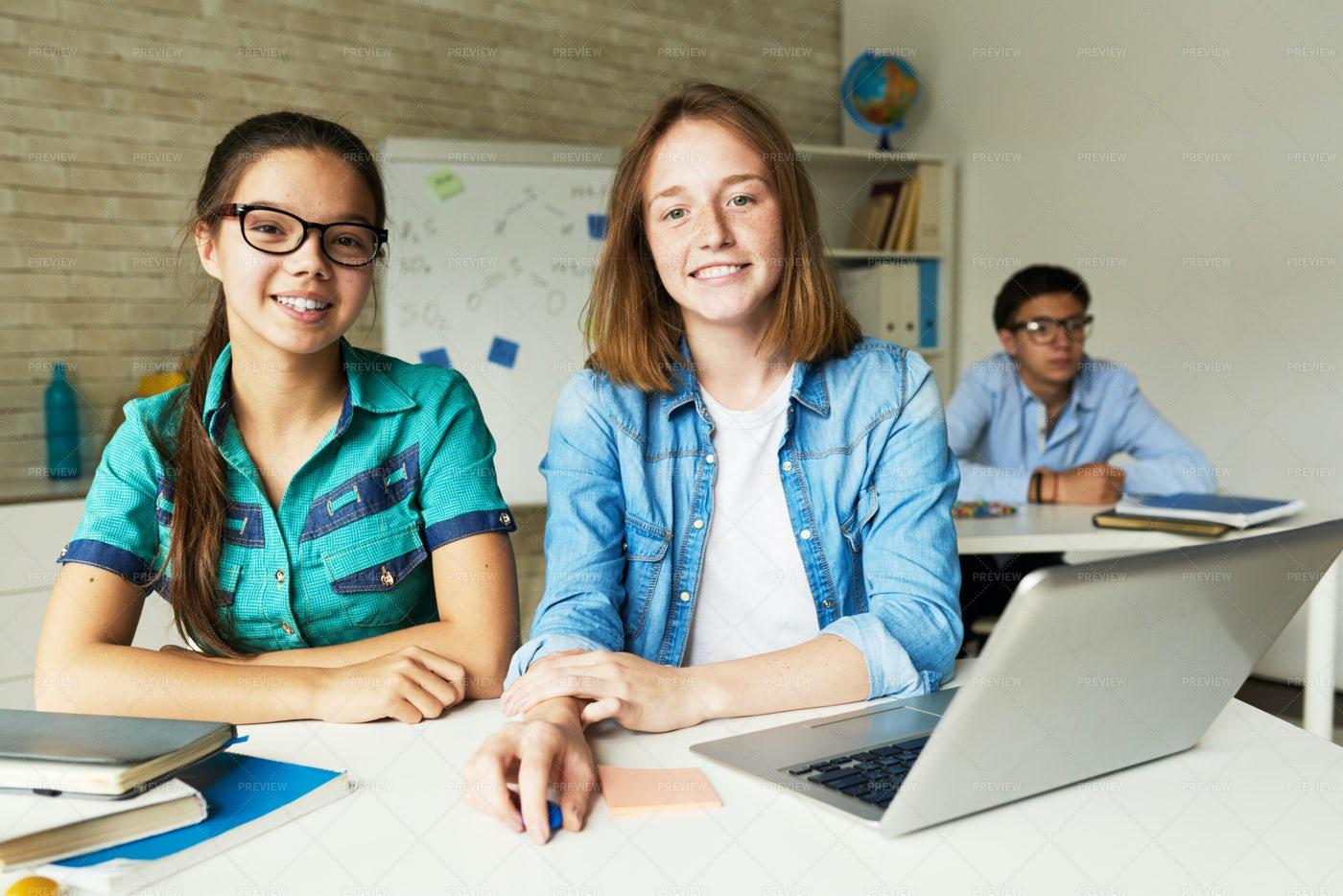 Schoolgirls In Modern Classroom: Stock Photos