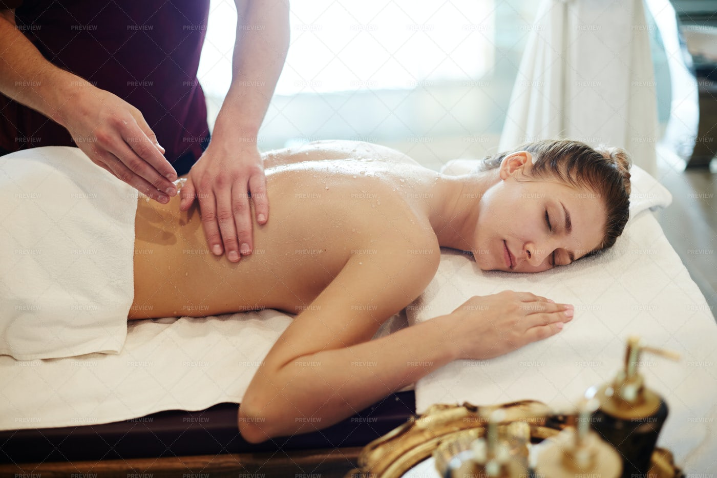Young Woman Enjoying Massage In SPA: Stock Photos