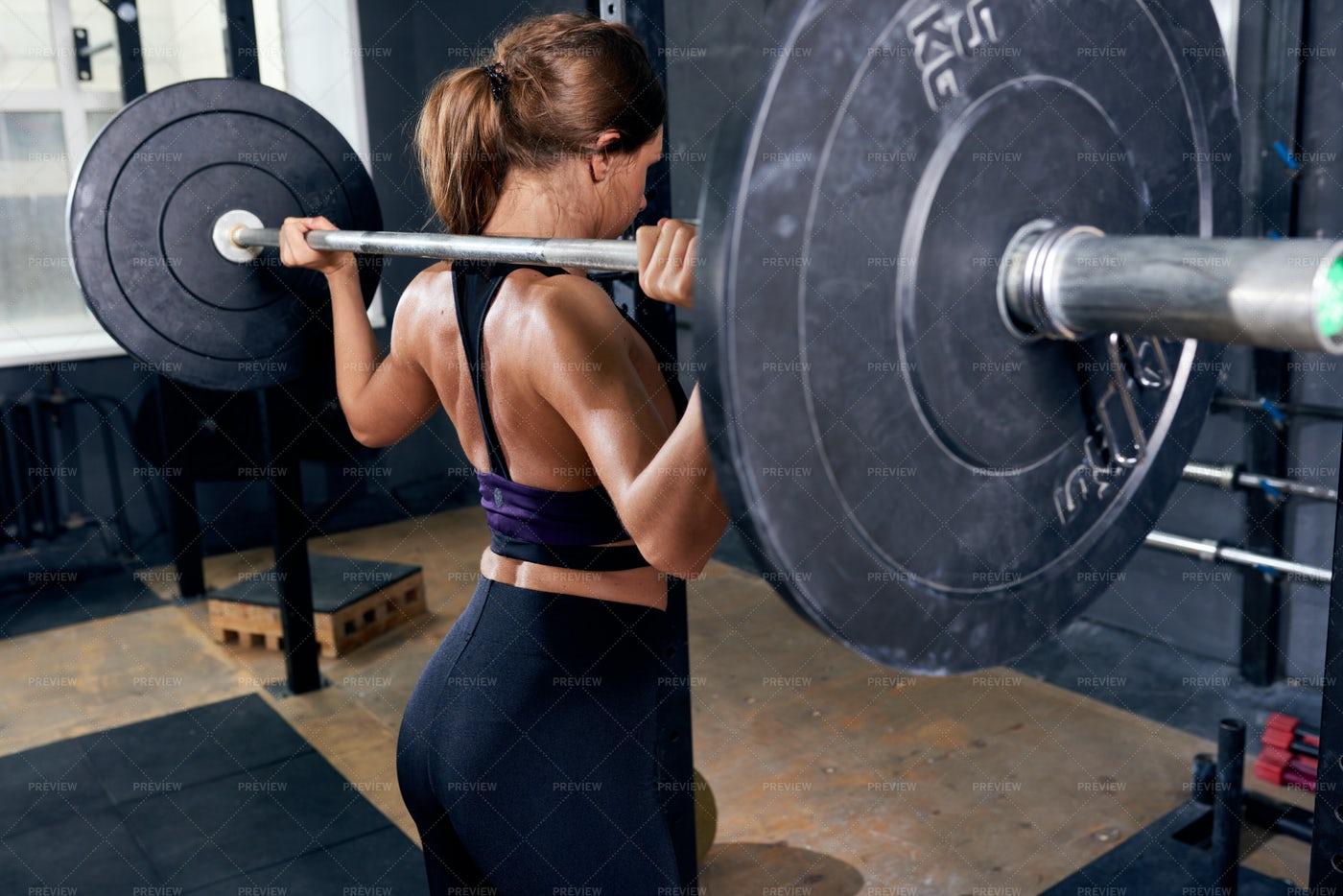 Beautiful Woman Holding Heavy...: Stock Photos