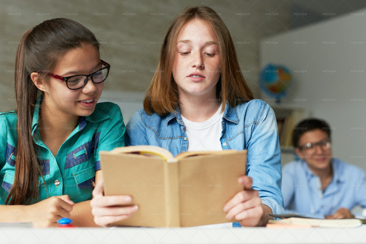 Teenage Students Wrapped Up In...: Stock Photos