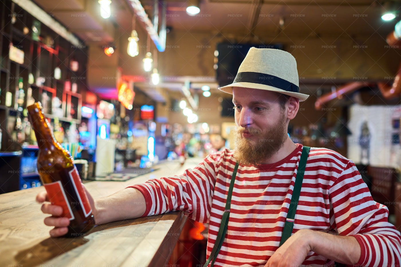 Bearded Young Man Chilling In Pub: Stock Photos